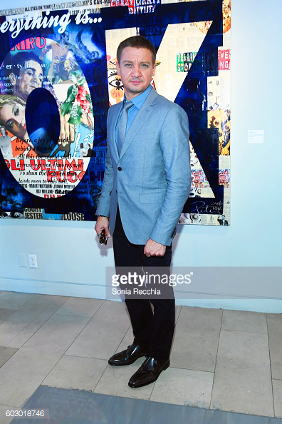 "JEREMY RENNER wore a grey 2 button jacket and black denim pants, styled with a light blue shirt, grey tie, and double monk-strap shoes while promoting his new film ""Arrival""."