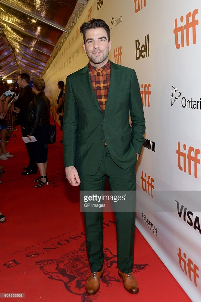 "ZACHARY QUINTO wore a forest green suit to the premiere of ""Snowden""."