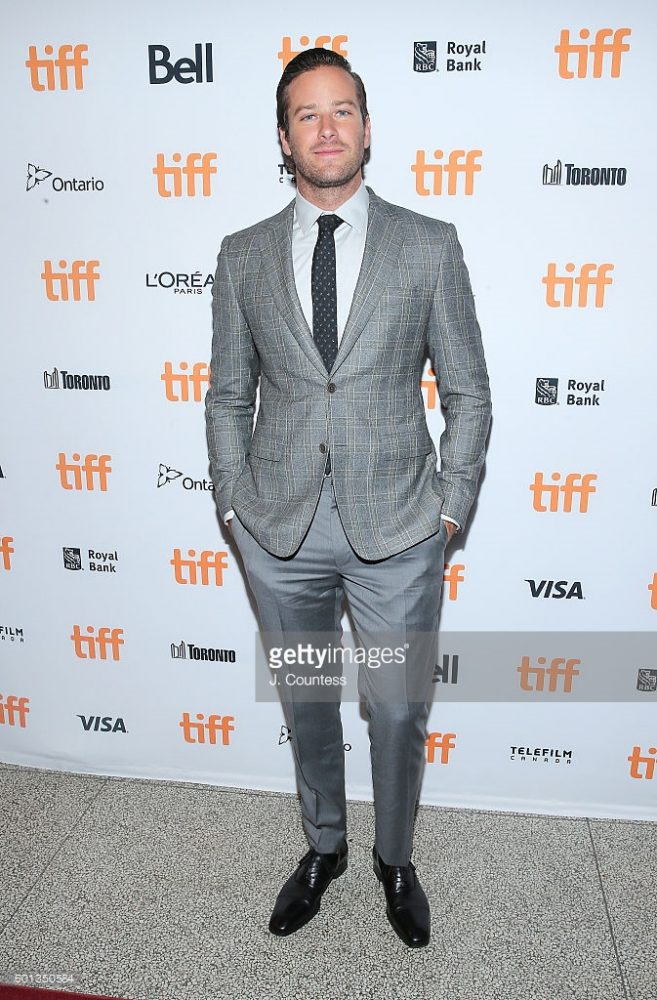 ARMIE HAMMER wore a grey Prince Of Wales wool jacket with matching grey pants